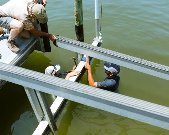 Boat Lift Installation - Orange Beach, AL - Webb's Hardware & Marine Services